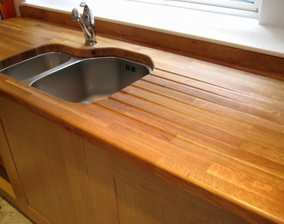 Пример декорирования столешницы из массива деревянным бортиком