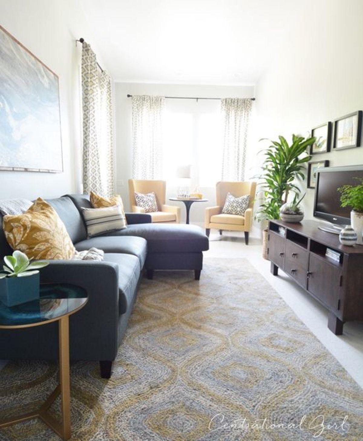 Ковры в гостиной помогут добавить тепла и комфорта, а также расширят визуально комнату