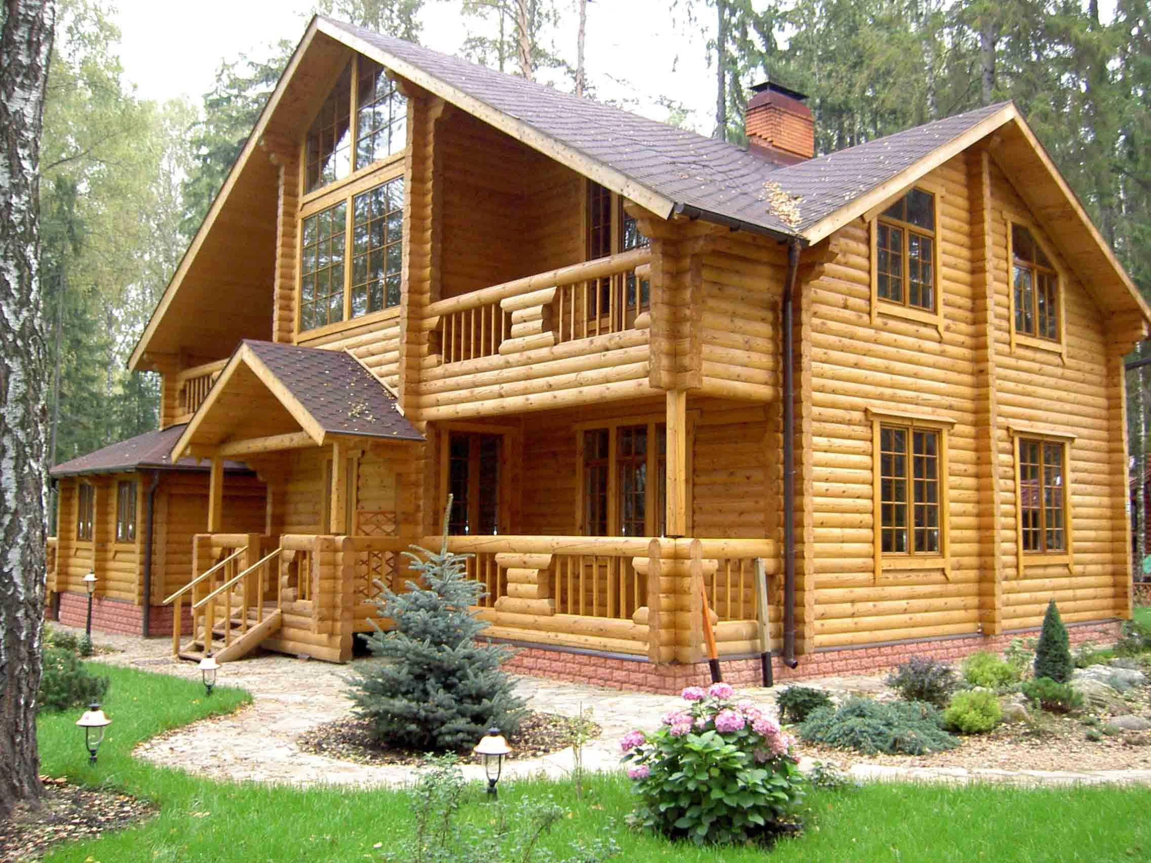 Фото дома из оцилиндрованного бревна