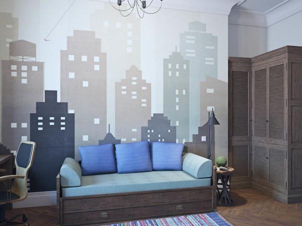 Акцентом в серо-кофейном интерьере комнаты подростка служат синие диванные подушки и яркий домотканый коврик на полу