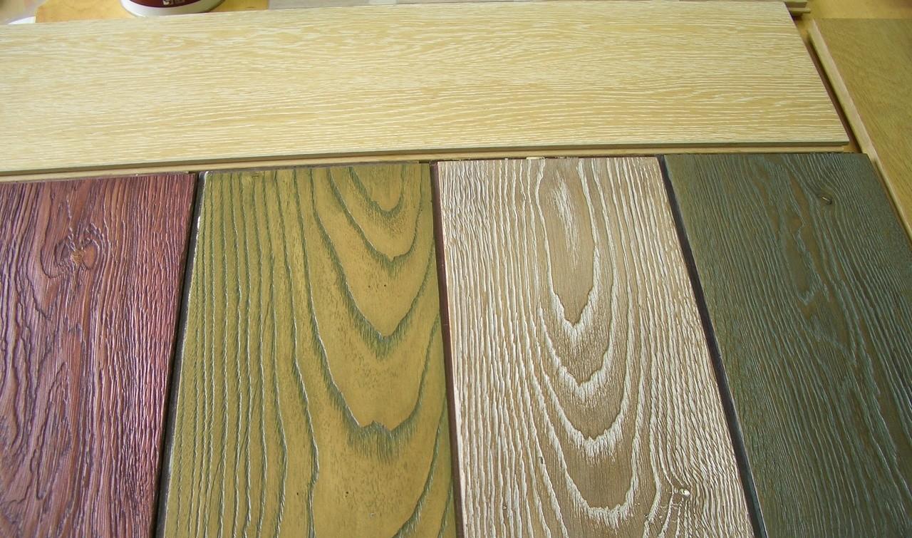 На фото показана цветовая гамма масляных пропиток для дерева.
