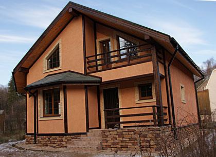 Оштукатуренный деревянный дом