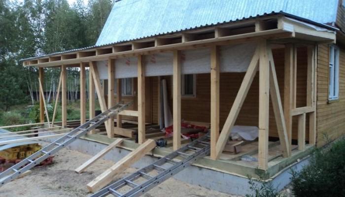 Процесс строительства террасы к деревянному дому